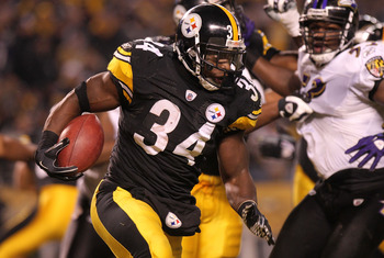 PITTSBURGH, PA - JANUARY 15:  Running back Rashard Mendenhall #34 of the Pittsburgh Steelers rushes against the Baltimore Ravens during the AFC Divisional Playoff Game at Heinz Field on January 15, 2011 in Pittsburgh, Pennsylvania.  (Photo by Nick Laham/G
