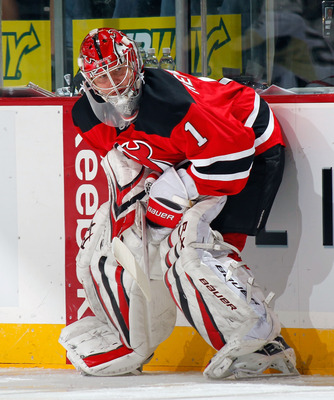 NEWARK, NJ - JANUARY 20:  Goalie Johan Hedberg #1 of the New Jersey Devils takes a break during warmups before his shutout win in an NHL hockey game against the Pittsburgh Penguins at the Prudential Center on January 20, 2011 in Newark, New Jersey.  (Phot