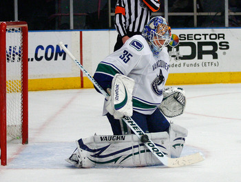 NEW YORK , NY - JANUARY 13: Goaltender Cory Schneider #35 of the Vancouver Canucks makes a stick save against the New York Rangers during the game at Madison Square Garden on January 13, 2011 in New York City. (Photo by Andy Marlin/Getty Images)