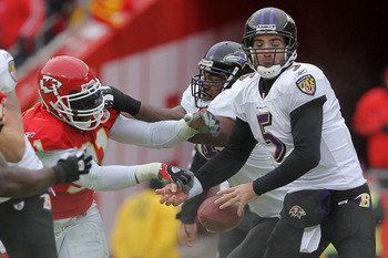 KANSAS CITY, MO - JANUARY 09:  Linebacker Tamba Hali #91 of the Kansas City Chiefs hits the ball out of the hands of quarterback Joe Flacco #5 of the Baltimore Ravens during their 2011 AFC wild card playoff game at Arrowhead Stadium on January 9, 2011 in