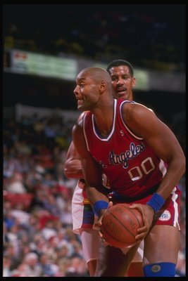 1988-1989:  Center Benoit Benjamin of the Los Angeles Clippers (right) keeps the ball away from Joe Cooper of the Denver Nuggets during a game at the McNichols Arena in Denver, Colorado. Mandatory Credit: Mike Powell  /Allsport