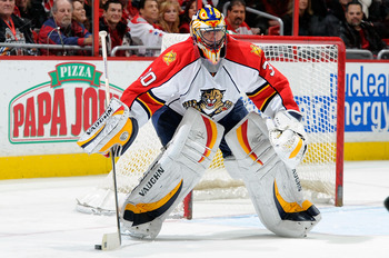 WASHINGTON - JANUARY 08:  Scott Clemmensen #30 of the Florida Panthers sweeps away the puck during the game against the Washington Capitals at the Verizon Center on January 8, 2011 in Washington, DC.  (Photo by Greg Fiume/Getty Images)
