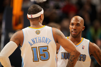 DENVER, CO - JANUARY 21:  Carmelo Anthony #15 and Chauncey Billups #1 of the Denver Nuggets talk during a break in the action against the Los Angeles Lakers at the Pepsi Center on January 21, 2011 in Denver, Colorado. The Lakers defeated the Nuggets 107-9