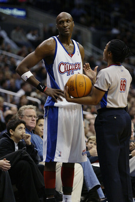 LOS ANGELES - FEBRUARY 19:  Lamar Odom #7 of the Los Angeles Clippers talks with referee Violet Palmer during the NBA game against the Milwaukee Bucks at Staples Center on February 19, 2003 in Los Angeles, California.  The Clippers won 110-104.  NOTE TO U