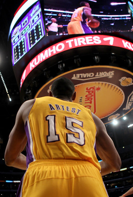 LOS ANGELES, CA - JANUARY 11:  Ron  Artest #15 of the Los Angeles Lakers inbounds the ball against the Cleveland Cavaliers at Staples Center on January 11, 2011 in Los Angeles, California.  The Lakers won 112-57.  NOTE TO USER: User expressly acknowledges