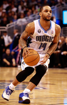 ORLANDO, FL - DECEMBER 18:  Jameer Nelson #14 of the Orlando Magic looks to pass against the Philadelphia 76ers during the game at Amway Arena on December 18, 2010 in Orlando, Florida.  NOTE TO USER: User expressly acknowledges and agrees that, by downloa