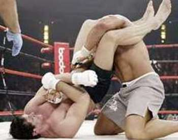 Roger Gracie securing an arm bar victory