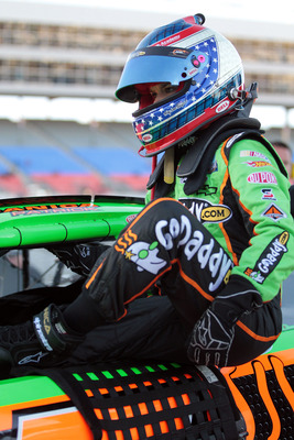 FORT WORTH, TX - NOVEMBER 05:  Danica Patrick, driver of the #7 GoDaddy.com Chevrolet, climbs out of her car after qualifying for the NASCAR Nationwide Series O'Reilly Auto Parts Challenge at Texas Motor Speedway on November 5, 2010 in Fort Worth, Texas.