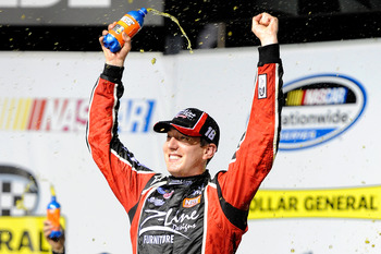 JOLIET, IL - JULY 09:  Kyle Busch, driver of the #18 Z-Line Designs Toyota, celebrates in victory lane after he won the NASCAR Nationwide Series Dollar General 300 Powered by Coca-Cola at the Chicagoland Speedway on July 9, 2010 in Joliet, Illinois.  (Pho
