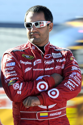 MARTINSVILLE, VA - OCTOBER 22:  Juan Pablo Montoya, driver of the #42 Target Chevrolet, walks on pit road during qualifying for the NASCAR Sprint Cup Series TUMS Fast Relief 500 at Martinsville Speedway on October 22, 2010 in Martinsville, Virginia.  (Pho