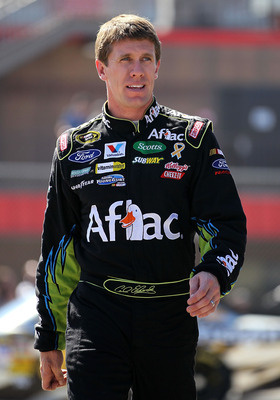 FONTANA, CA - OCTOBER 08:  Carl Edwards, driver of the #99 Aflac Ford, walks in the garage area during practice for the NASCAR Sprint Cup Series Pepsi Max 400 on October 8, 2010 in Fontana, California.  (Photo by Jeff Gross/Getty Images)