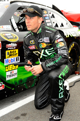 LONG POND, PA - AUGUST 01:  Jamie McMurray, driver of the #1 AXE Twist Chevrolet, kneels by his car prior to the NASCAR Sprint Cup Series Sunoco Red Cross Pennsylvania 500 at Pocono Raceway on August 1, 2010 in Long Pond, Pennsylvania.  (Photo by John Har