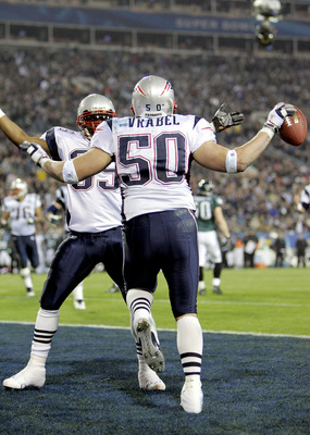 JACKSONVILLE, FL - FEBRUARY 06:  Linebacker Mike Vrabel #50 of the New England Patriots celebrates with teammate Patrick Pass #35 after Vrabel made a 2-yard touchdown reception against the Philadelphia Eagles in the third quarter during Super Bowl XXXIX a