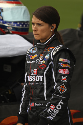 JOLIET, IL - JUNE 04:  Danica Patrick, driver of the #7 Tissot/GoDaddy.com Chevrolet, prepares for qualifying for the NASCAR Nationwide STP 300 at Chicagoland Speedway on June 4, 2011 in Joliet, Illinois. Qualifying was canceled due to rain.  (Photo by Jo