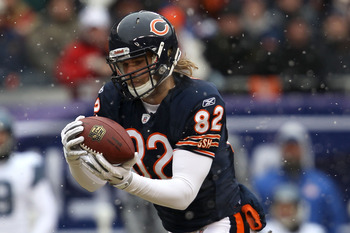 CHICAGO, IL - JANUARY 16:  Tight end Greg Olsen #82 of the Chicago Bears catches a 58-yard touchdown in the first quarter in front of Lawyer Milloy #36 of the Seattle Seahawks in the 2011 NFC divisional playoff game at Soldier Field on January 16, 2011 in