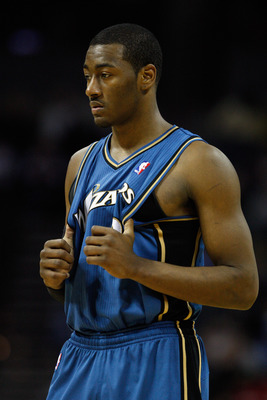 CHARLOTTE, NC - JANUARY 08:  John Wall #2 of the Washington Wizards waits to play against the Charlotte Bobcats during their game at Time Warner Cable Arena on January 8, 2011 in Charlotte, North Carolina. NOTE TO USER: User expressly acknowledges and agr