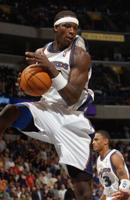 WASHINGTON - OCTOBER 31:  Kwame Brown #5 of the Washington Wizards comes down with a rebound during the game against the Boston Celtics at MCI Center on October 31, 2002 in Washington, D.C.  The Wizards won 114-69.  NOTE TO USER: User expressly acknowledg