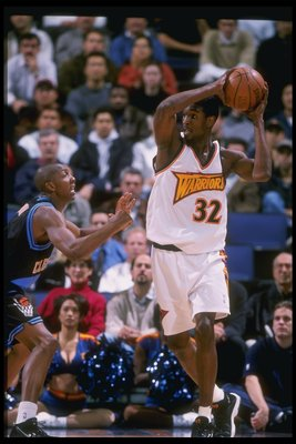 3 Dec 1997: Forward Joe Smith of the Golden State Warriors looks to pass the ball during a game against the Cleveland Cavaliers during a game at the Oakland Arena in Oakland, California. The Cavaliers won the game 95-67.