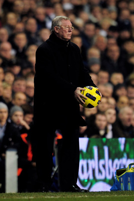LONDON, ENGLAND - JANUARY 16:  Sir Alex Ferguson the Manchester United manager handles the ball during the Barclays Premier League match between Tottenham Hotspur and Manchester United at White Hart Lane on January 16, 2011 in London, England.  (Photo by