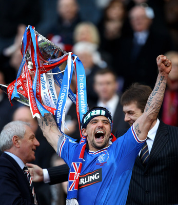 GLASGOW, SCOTLAND - MARCH 21:  Nacho Novo of Rangers lifts the CIS Insurance Cup after beating St Mirren 1-0 in the final at Hampden Park on March 21, 2010 in Glasgow, Scotland.  (Photo by Jeff J Mitchell/Getty Images)