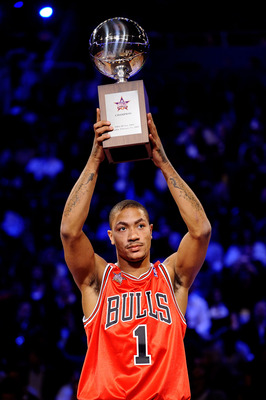 PHOENIX - FEBRUARY 14:  Derrick Rose of the Chicago Bulls holds up the trophy after winning the Play Station Skills Challenge on All-Star Saturday Night, part of 2009 NBA All-Star Weekend at US Airways Center on February 14, 2009 in Phoenix, Arizona.  NOT