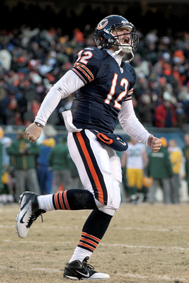 CHICAGO, IL - JANUARY 23:  Quarterback Caleb Hanie #12 of the Chicago Bears reacts after Chester Taylor #29 scores a one-yard touchdown in the fourth quarter against the Green Bay Packers in the NFC Championship Game at Soldier Field on January 23, 2011 i