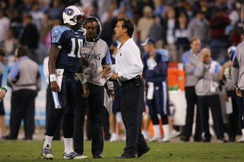 NASHVILLE, TN - NOVEMBER 26:  Head coach Jeff Fisher of the Tennessee Titans talks to quarterback Vince Young #10 as quarterbacks coach Craig Johnson looks on against the New York Giants at LP Field on November 26, 2006 in Nashville, Tennessee. The Titans