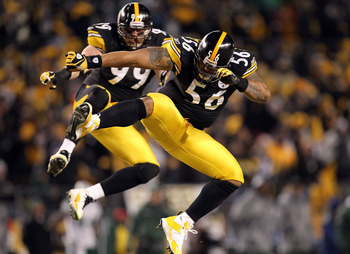 PITTSBURGH, PA - JANUARY 23:  LaMarr Woodley #56 and Brett Keisel #99 of the Pittsburgh Steelers celebrate after sacking Mark Sanchez #6 of the New York Jets during the 2011 AFC Championship game at Heinz Field on January 23, 2011 in Pittsburgh, Pennsylva