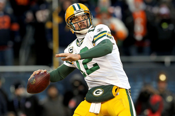 CHICAGO, IL - JANUARY 23:  Quarterback Aaron Rodgers #12 of the Green Bay Packers throws a pass in the second half against the Chicago Bears in the NFC Championship Game at Soldier Field on January 23, 2011 in Chicago, Illinois.  (Photo by Jamie Squire/Ge