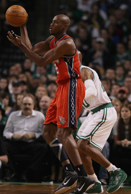 BOSTON - NOVEMBER 24:  Travis Outlaw #21 of the New Jersey Nets passes the ball as Ray Allen #20 of the Boston Celtics defends on November 24, 2010 at the TD Garden in Boston, Massachusetts. NOTE TO USER: User expressly acknowledges and agrees that, by do