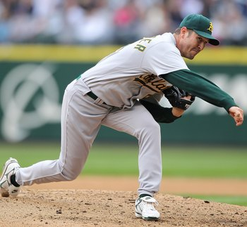 SEATTLE - APRIL 12:  Starting pitcher Justin Duchscherer #58 of the the Oakland Athletics pitches against the Seattle Mariners during the Mariners' home opener at Safeco Field on April 12, 2010 in Seattle, Washington. (Photo by Otto Greule Jr/Getty Images
