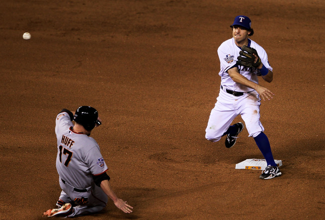 ARLINGTON, TX - NOVEMBER 01:  Aubrey Huff #17 of the San Francisco Giants is out at second as Ian Kinsler #5 of the Texas Rangers turns a double play in the fifth inning of Game Five of the 2010 MLB World Series at Rangers Ballpark in Arlington on Novembe