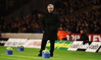 WOLVERHAMPTON, UNITED KINGDOM - JANUARY 05:  Carlo Ancelotti the Chelsea manager watches from the touchline during the Barclays Premier League match between Wolverhampton Wanderers and Chelsea at Molineux on January 5, 2011 in Wolverhampton, England.  (Ph