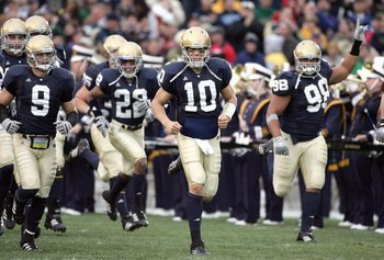 SOUTH BEND, IN - NOVEMBER 4: Quarterback Brady Quinn #10 and Tom Zbikowski #9 of the Notre Dame Fighting Irish run onto the field before the game against the North Carolina Tar Heels on November 4, 2006 at Notre Dame Stadium in South Bend, Indiana. (Photo
