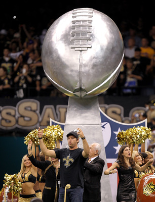NEW ORLEANS - SEPTEMBER 09:  Harry Connick Jr. leads a float out onto the field which carried the VInce Lombardi Super Bowl Trophy won last year by the New Orleans Saints prior to the Saints playing against the Minnesota Vikings at Louisiana Superdome on