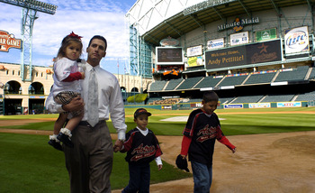 HOUSTON - DECEMBER 11:  Former New York Yankees pitcher Andy Pettitte, holds his daughter, Lexy, 2, as he walks with his sons Jared, 5, and Joshua, 9, far right, as they walk on the field at Minute Maid Park following a news conference announcing him as t