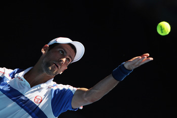 MELBOURNE, AUSTRALIA - JANUARY 23:  Novak Djokovic of Serbia plays a serves in his fourth round match against Nicolas Almagro of Spain during day seven of the 2011 Australian Open at Melbourne Park on January 23, 2011 in Melbourne, Australia.  (Photo by C