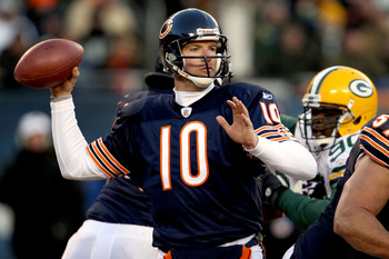 CHICAGO, IL - JANUARY 23:  Quarterback Todd Collins #10 of the Chicago Bears throws the ball in the third quarter against the Green Bay Packers in the NFC Championship Game at Soldier Field on January 23, 2011 in Chicago, Illinois.  (Photo by Jonathan Dan