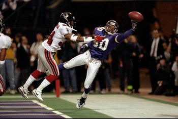 17 Jan 1999: Cris Carter #80 of the Minnesota Vikings tries for the catch during the NFC Championship Game against the Atlanta Falcons at the H. H. H. Metrodome in Minneapolis, Minnesota. The Falcons defeated the Vikings 30-27. Mandatory Credit: Andy Lyon