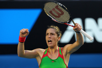 MELBOURNE, AUSTRALIA - JANUARY 23:  Andrea Petkovic of Germany celebrates her match point after winning her fourth round match against Maria Sharapova of Russia during day seven of the 2011 Australian Open at Melbourne Park on January 23, 2011 in Melbourn