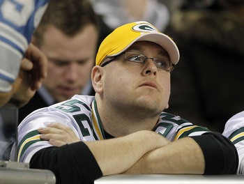 DETROIT - DECEMBER 12:  Green Bay Packers fan reacts after the Detroit Lions defeated the Green Bay Packers 7-3 at Ford Field on December 12, 2010 in Detroit, Michigan.  (Photo by Leon Halip/Getty Images)