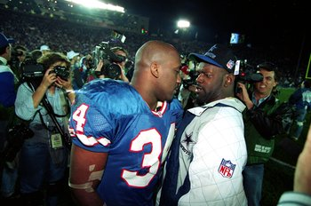 31 Jan 1993:  Emmitt Smith #22 of the Dallas Cowboys talks to a Buffalo Bills player after Superbowl XXVII at the Rose Bowl in Pasadena, California. The Cowboys defeated the Bills 52-17. Mandatory Credit: Mike Powell  /Allsport