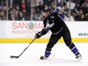 LOS ANGELES, CA - JANUARY 08:  Justin Williams #14 of the Los Angeles Kings shoots the puck against the Columbus Blue Jackets at the Staples Center on January 8, 2011 in Los Angeles, California.  (Photo by Harry How/Getty Images)