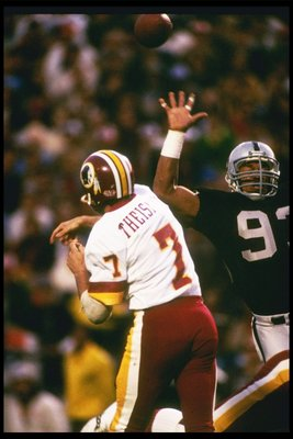 22 Jan 1984:  Quarterback Joe Theismann of the Washington Redskins passes the ball during Super Bowl XVIII against the Los Angeles Raiders at Tampa Stadium in Tampa, Florida.  The Raiders won the game, 38-9. Mandatory Credit: Allsport  /Allsport