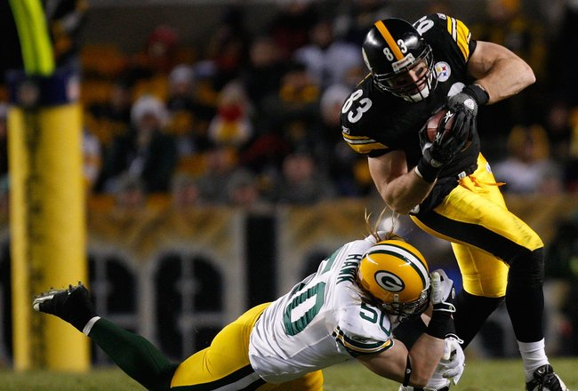 PITTSBURGH - DECEMBER 20: Heath Miller #83 of the Pittsburgh Steelers attempts to break through a tackle by AJ Hawk #50 of the Green Bay Packers during the game on December 20, 2009 at Heinz Field in Pittsburgh, Pennsylvania. (Photo by Jared Wickerham/Get