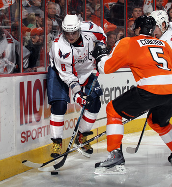 PHILADELPHIA, PA - JANUARY 18: Braydon Coburn #5 of the Philadelphia Flyers checks Alex Ovechkin #8 of the Washington Capitals at the Wells Fargo Center on January 18, 2011 in Philadelphia, Pennsylvania. The Flyers defeated the Capitals 3-2 in overtime. (