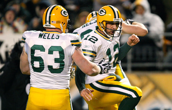 PITTSBURGH - DECEMBER 20: Aaron Rodgers #12 celebrates with Jordy Nelson #87 and Scott Wells #63 of the Green Bay Packers after running in for a touchdown against the Pittsburgh Steelers during the game on December 20, 2009 at Heinz Field in Pittsburgh, P