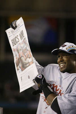 SAN DIEGO - JANUARY 26:  Most Valuable Player safety Dexter Jackson #34 of the Tampa Bay Buccaneers holds a newspaper proclaiming that his team defeated the Oakland Raiders in the Super Bowl XXXVII at Qualcomm Stadium on January 26, 2003 in San Diego, Cal
