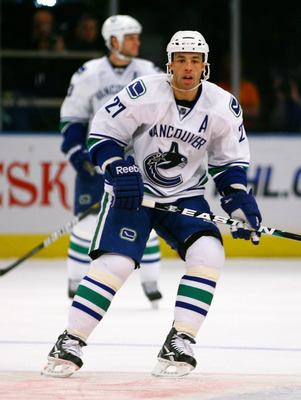 NEW YORK , NY - JANUARY 13: Manny Malhotra #27 of the Vancouver Canucks skates against the New York Rangers during the game at Madison Square Garden on January 13, 2011 in New York City. (Photo by Andy Marlin/Getty Images)