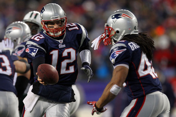 FOXBORO, MA - JANUARY 16:  Tom Brady #12 of the New England Patriots drops back with BenJarvus Green-Ellis #42 of the New England Patriots against the New York Jets during their 2011 AFC divisional playoff game at Gillette Stadium on January 16, 2011 in F